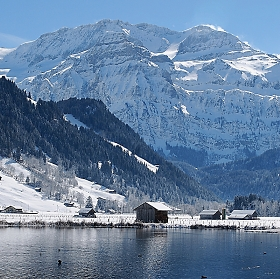 lenk lake and snowy mountains