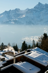 snowy rooftops in villars switzerland