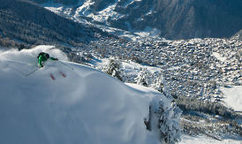 powder skiing over the verbier village